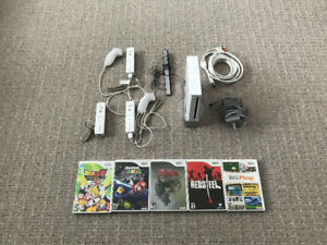 Wii with 3 controllers and 5 games