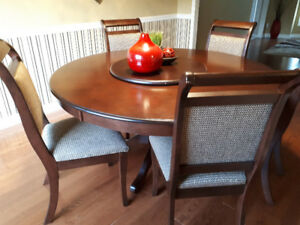 Solid wooden dining table with chairs and lazy susan