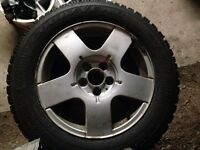 VW Alloy Five spoke rims with WINTER TIRES.Good tread 5x100 bolt