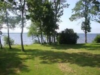 Waterfront & 15+/- Acres,incl.Century home on Grand Lake
