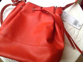 Orange draw string bag brand new tagged