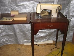 Sewing machine & cabinet REDUCED TO $75. FROM $95.