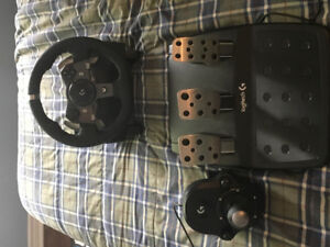 Logitech steering wheel and shifter. Used twice.