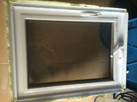 Fully encased white aluminum window with screen - crank style -