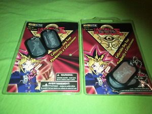 For sale yu-gi-uh dog tags in good condition.