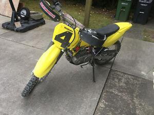 Suzuki 125 1700$ or trades for a bigger bike