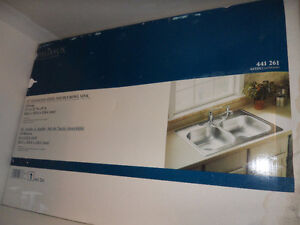 New stainless steel double sinks