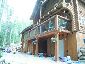 Off grid riverfront log home on 3 acres