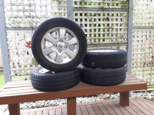 4 Aluminum rims with tires for Nissan 195/ 65 R15/ M+S