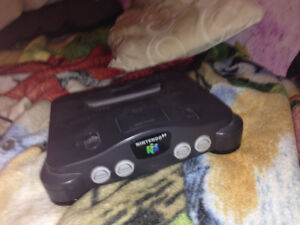 N64 with 3 games 2 controllers chords included
