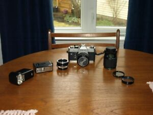 35  mm camera (film) camera; 2 lenses; converter 2x; 2 flashes