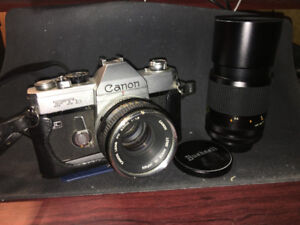 Vintage Canon FTb 35mm Film Camera, w/ extra lens and cases.