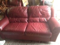 Large three and two red leather settees