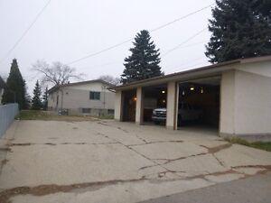 *1700sq ft Bungalow plus 1000sq ft Heated Triple Garage/Shop*