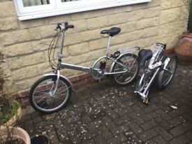Two matching folding bicycles