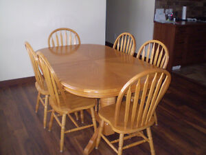 Oak dining room table with chairs