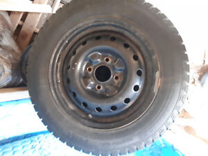 Almost new winter tires on steelies with studs