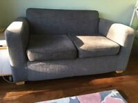 Dark grey fabric two seater sofa with wooden feet