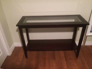 Dark wood console table with glass insert