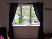Two pairs of black eyelet curtains