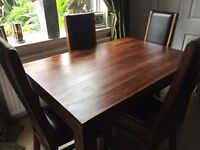 Immaculate solid wood table with real leather seats