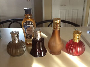 Set of 4 oil burning lamps along with a bottle of fragrance oil