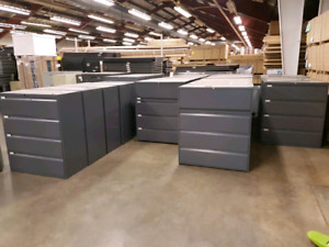 Large quantity of lateral filing cabinets.