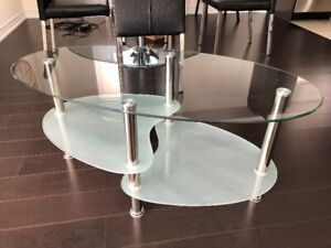 Glass coffee table with shelves on metal legs