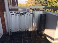 Large set of golf clubs