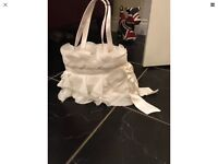 Cost white/ivory frilly bag with satin bow detail never been used