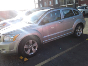 Dodge Caliber 2011. Very cheap on gas.