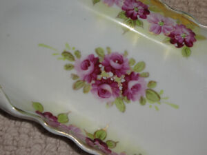 Antique rolled edged porcelain flat dish  with roses and  gold