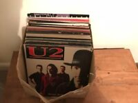Box of vinyl records LPs including U2 and the Eagles