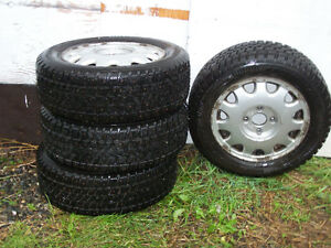 Studded Artic Claw snow tires & Honda rims