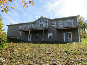 OWN THIS LAKEFRONT HOME FOR $ 1800.00 PER MONTH