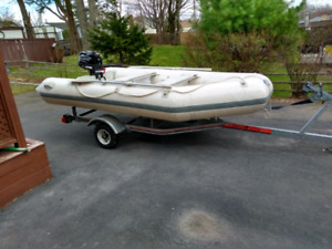 zodiac style boat with motor and trailer