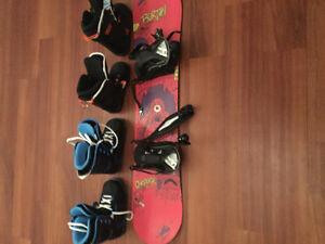 Burton snowboard with 2 pairs of firefly boots and bindings