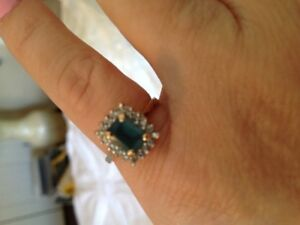 Beautiful blue topaz stone surrounded by diamonds, 10 carat Gold