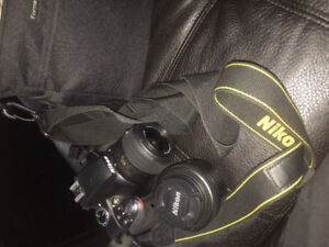 Nikon D3300 DLSR with 35mm lens, 18-55mm lens and extras.