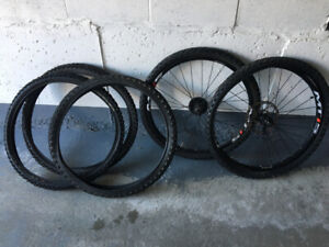 Set of Shimano MT15 wheels with 5 tires