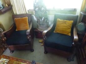 A pair of antique club chairs with loads of character , very unusual old things. ONO