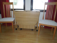Space saving table with 4 chairs with storage space