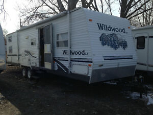 31 foot travel trailer with 4 bunks and slide out-sleeps 10