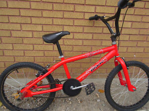 "red mountain bike (BMX).tire size 20""',like new no rust London Ontario image 4"