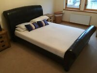 King size dark brown leather bed