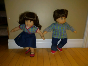 """American Girl """" Bitty Baby Twins """" and extra outfits."""