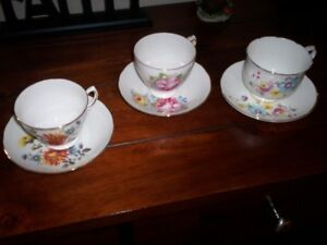 3 china tea cups with saucers