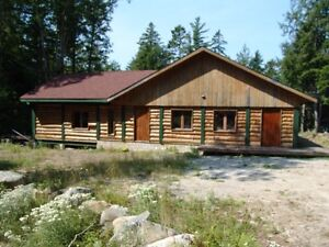 Author's Nova Scotian (lakeside) log house for sale.