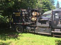 Camion de réparation d'asphalte