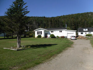 Home For Sale on 0.9 Acres of land with an Ocean View!